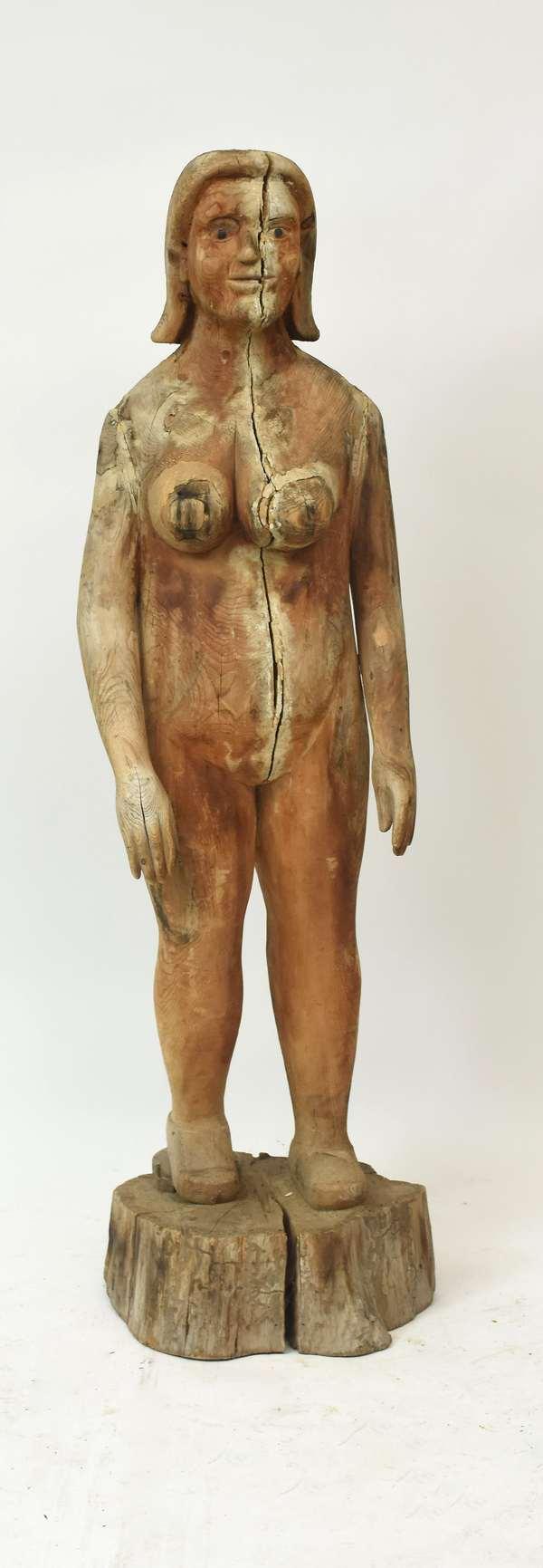 "Life-size carved wooden Outsider Folk Art female figurine, 67""H."