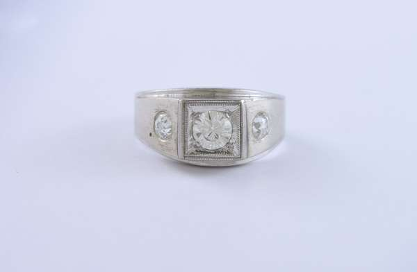 14K white gold gentleman's ring set with approx. .50ct center diamond with 2 others approx. .35 ctw, ring size 10.5
