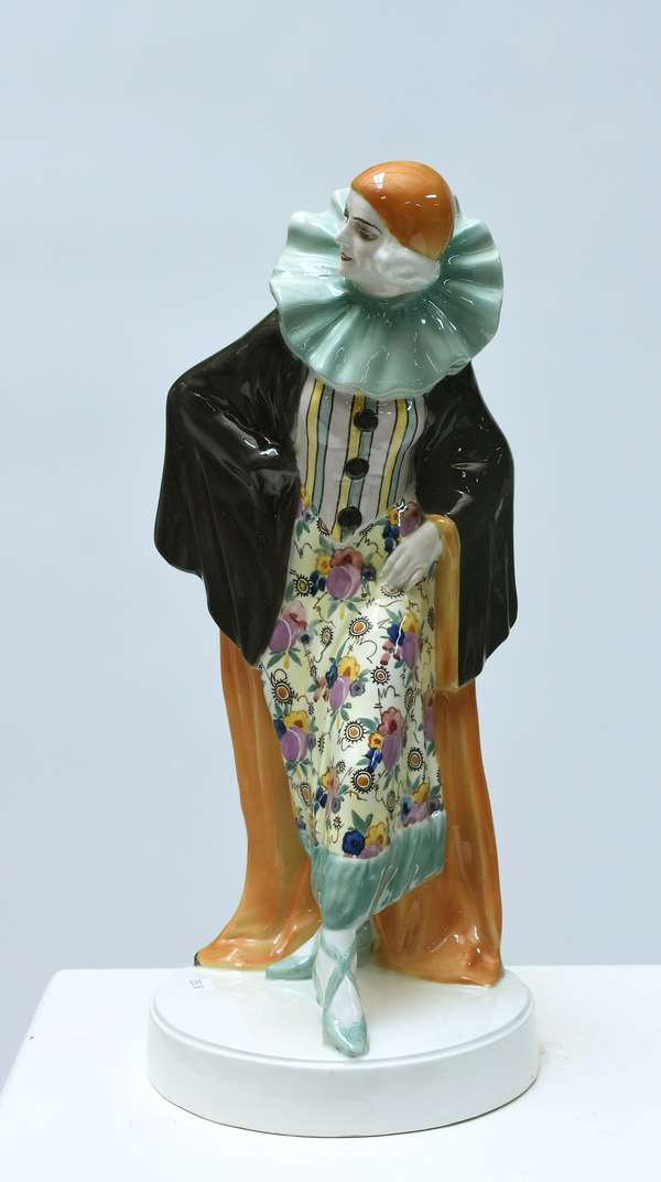 """Large Goldscheider Art Deco figure of Harlequin titled """"Le Palais Royal Habara"""", woman in harlequin attire wearing black, orange, and turquoise cape, 17""""H., marked Made in Austria Goldscheider Wien, impressed 509-119-10, Roman numeral XXVII (27) D_.; impressed """"L"""" (Lorenzl) on back of base, ca.1930"""