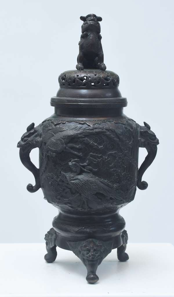 """Asian patented bronze censer, raised figures of falcons on one side, and water birds on the other. Fierce figural handles and feet, Foo dog finial. 18""""H., artist signed on bottom, 19th/20th C."""