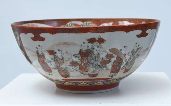 """Large Kutani bowl, well painted with panels of women walking in a landscape, exterior painted with panels of men and children walking in a landscape, 12""""D. x 5.5""""H., 19th C."""