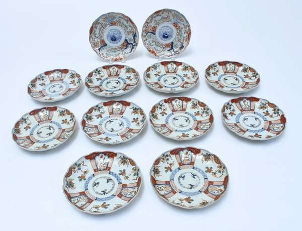 """Twelve Japanese Imari scalloped plates, ten that match and a pair that are similar, 8.5""""D., ca. 1890"""