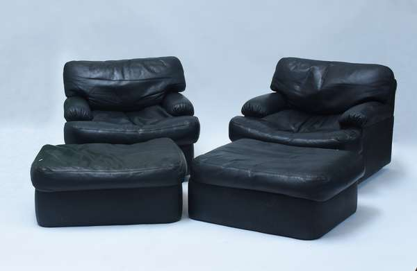 """Pair black leather chairs and ottomans, chairs are large scale, low, and very comfortable, swivel bases.  Chairs 36""""W. x 36""""D. x 26""""H. at the back. Very high quality, ca.1970's"""