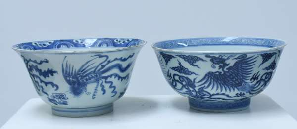 """Two Asian 19th C. blue and white bowls, Phoenix decoration with clouds, 7.5""""W. x 3.75""""H., both signed on bottom."""