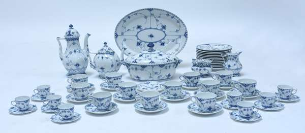 """Royal Copenhagen Blue Flute pattern china set, 62 pieces, including a 12.5"""" oval covered soup tureen; 16"""" oval platter; coffee pot w/ cover; tea pot w/cover; sugar bowl and creamer, and 12 each of coffee cups and saucers, demitasse cups and saucers, and 7.5""""Dia. luncheon plates, the set is second quality"""