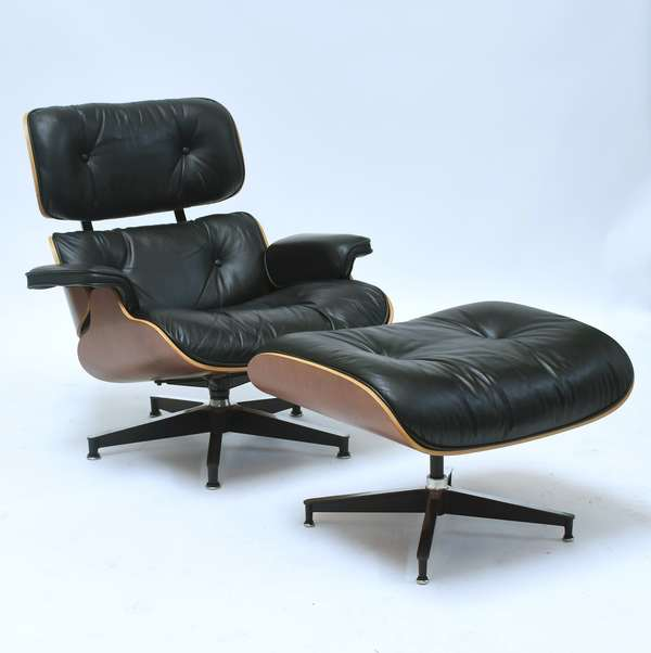 Herman Miller black leather Eames chair and ottoman on cherry frame, original tags on bottom