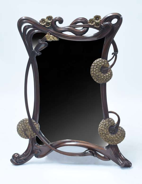 """Carved and gilt mahogany Art Nouveau style mirror, carved dandelion seed pods and poppies, 47.5""""H. x 39""""W."""