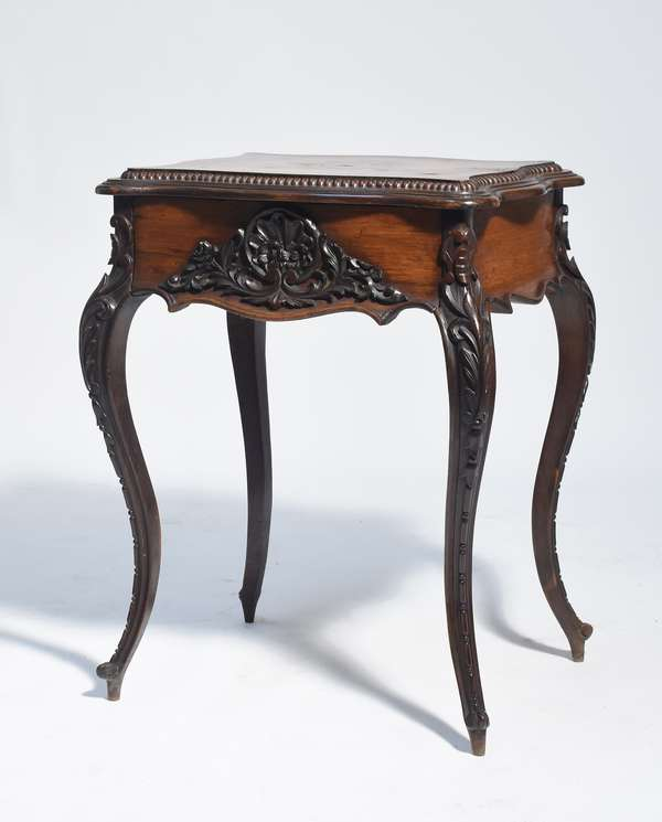 """American rosewood Victorian sewing lift top cabinet, compartmentalized interior with mirror in lid, cabriole legs, carved case, 31""""H. x 24""""W."""