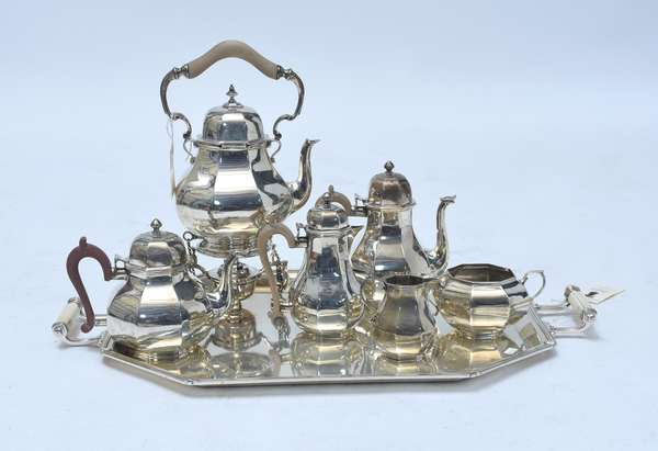 """English sterling six piece coffee and tea set with sterling tray, 15"""" kettle on stand; 8"""" coffee pot; 6.75"""" tea pot;7.25"""" hot milk, sugar, creamer, sterling tray. Approx. 240 ozs troy weight total  Retailed by Hancocks of London"""
