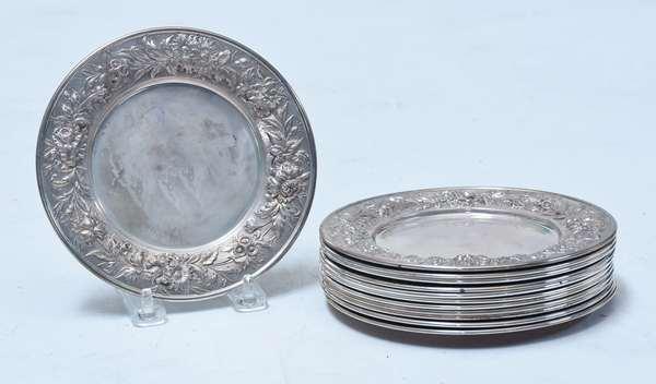 "Twelve sterling Kirk repoussé 6.25"" butter plates, Repoussé border, no monogram to center, approx. 48.5 ozs troy weight, ca. 1950."
