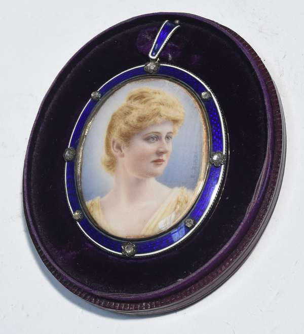 """19th/20th C. hand painted oval miniature, in gold and silver enamel, set with rose cut diamonds around bezel.  Artist signed """"E. Rinzi"""" in original leather fitted carrying case, miniature 1.75""""H."""