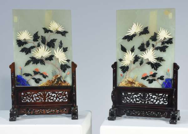 """Pair Chinese jade and hardstone table screens, proper pair with jade, agate, lapis lazuli, and other materials.  Carved rosewood stands, panels 11""""H. x 8.25""""W., 15.75"""" overall."""