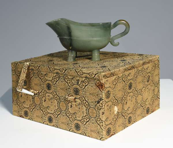 """Republic period Chinese carved jade archaic form sauce boat, 5.75""""W., in original fitted box."""