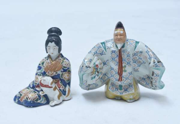 "Pair Japanese Ko-Kutani figures;  standing man and seated woman with a pug dog.  Man 6.75"", woman 6""H., 19th C."