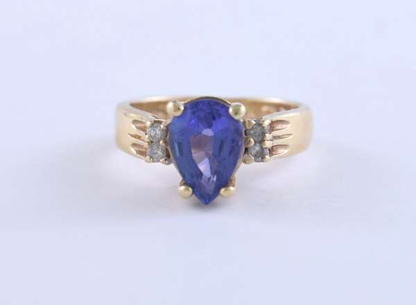 Pear shaped tanzanite and diamond ring set in 14k yellow gold