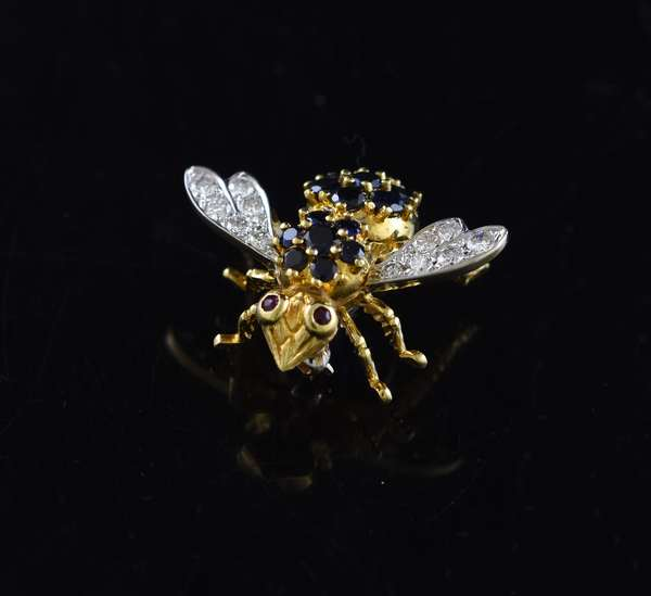 18k yellow gold sapphire, diamond bee pin with ruby eyes, approx. 1.25 ctw sapphires, .60 ctw diamonds, 10.5 grams