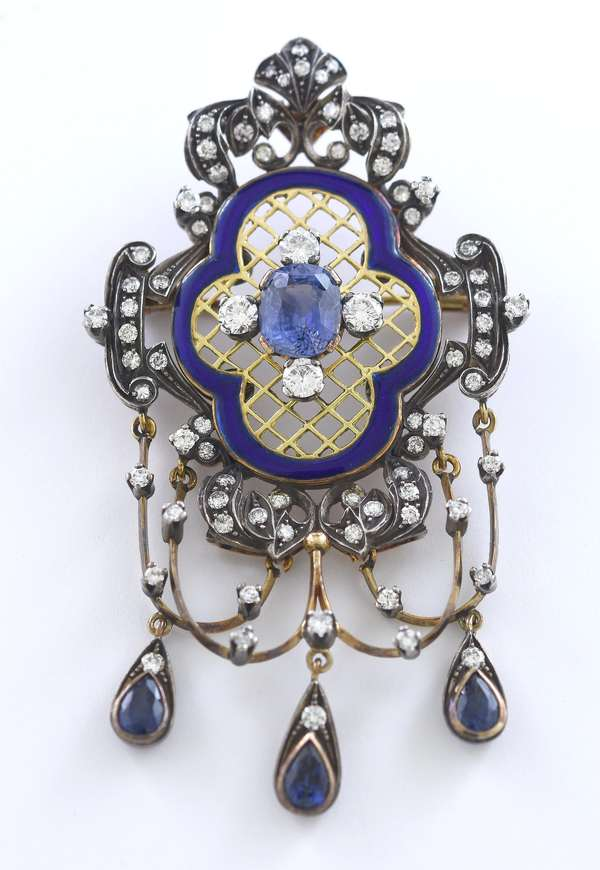 "Silver topped 18k yellow gold sapphire and diamond pendant/brooch, set with approx. 3.25 ctw. sapphires and 2 ctw. diamonds with blue enamel, 2.75""L 24.6 grams"