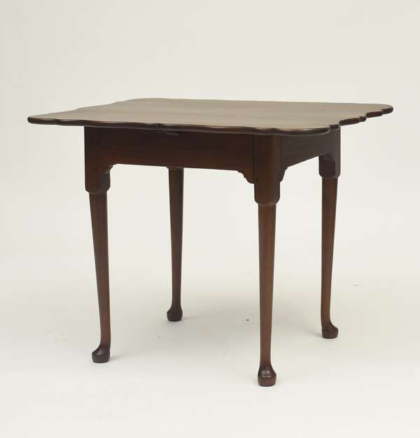 "American shaped top mahogany tea table, Rhode Island or Eastern Connecticut ca.1750, 32""L. x 23""W. x 26""H."
