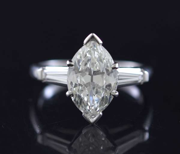 Platinum marquise solitaire ring, approx. 1.96 ct., measures(11.85 x 7.58 x 3.78 mm deep), approx.  .30 ct. tw. side baguettes, sz. 6, 5.5 grams.