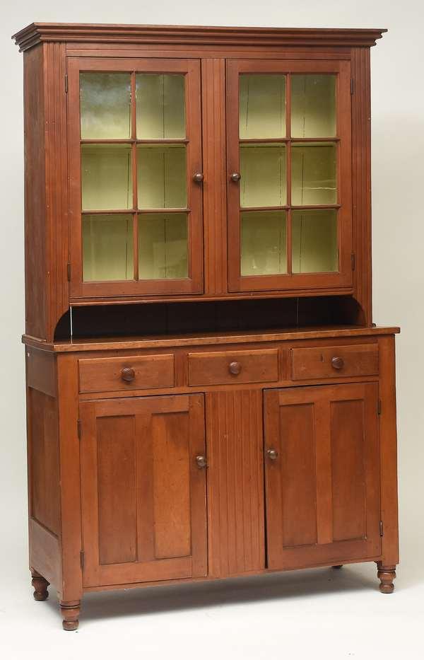 "Mid 19th C. PA cherry set-back cupboard with glass door top over blind door base, 51.5""W. x 85""H. x 19""D."