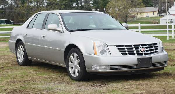 2006 Cadillac DTS 4 door sedan, silver, with original purchase papers, single owner, 36,500 miles
