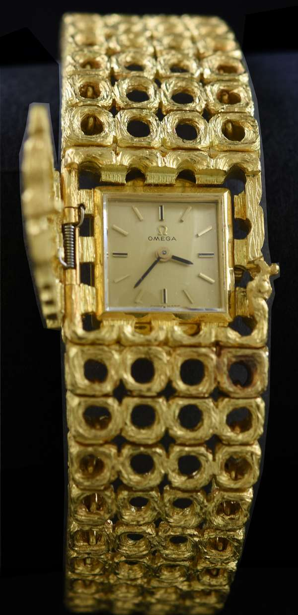 Ladies 18kt yellow gold Omega bracelet watch w/ hidden movement, 20.5 mm, 85.4 grams.