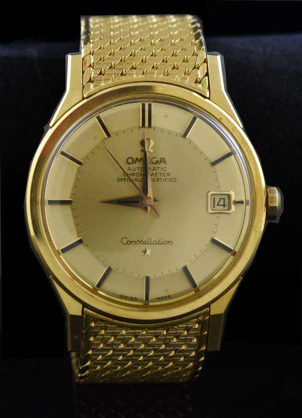 Gents Omega Constellation stamped 750 or 18kt yellow gold wrist watch, gold mesh strap, automatic with date, 34 mm, 112.2 grams (two sections removed, 4.4 grams)