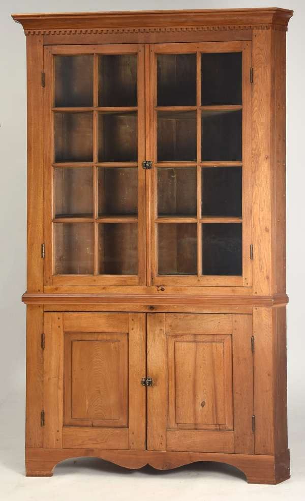 "Federal walnut corner cupboard with molded cornice with dentil molding, original glass top and raised panel doors below, 85.5""H."