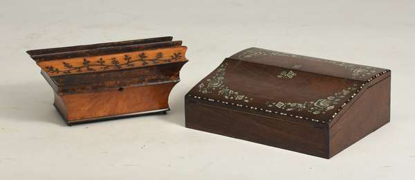 "Two 19th C. boxes: walnut dressing box, with fitted interior with ladies necessities, 6""H. x 14""L., and a rosewood and mother-of-pearl inlaid writing box, with interior boxes and ink wells, 14""L. x 5""H."