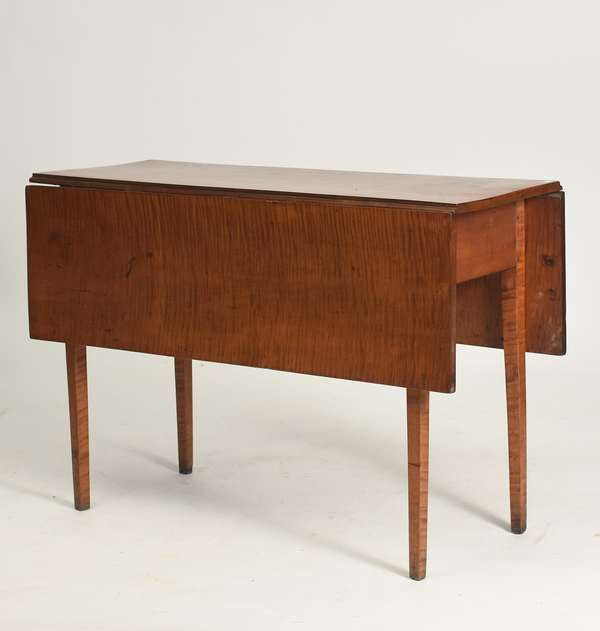 """19th C. American tiger maple drop-leaf table, with tapered legs, 42.5""""L. x 41""""W. open, x 28.5""""H."""