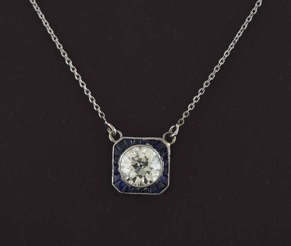 "1.81 ct old European cut diamond surrounded by approx. .35 ctw calibre cut blue sapphires set in square platinum on fine 14k white gold chain, 18""L., 3.6 grams"