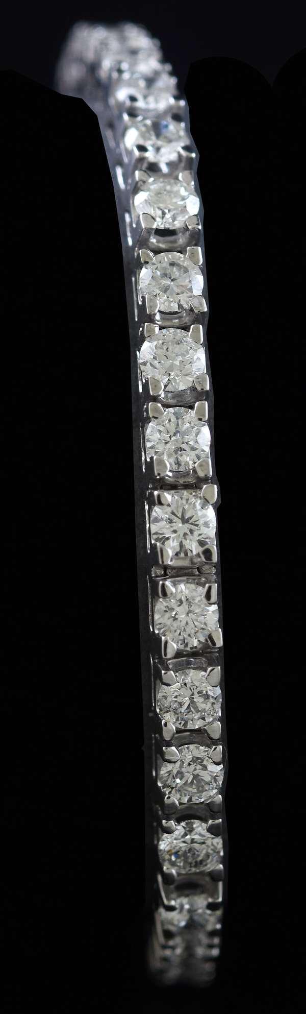 Platinum line bracelet set with approx. 8.0 ctw round brilliant cut diamonds, 7