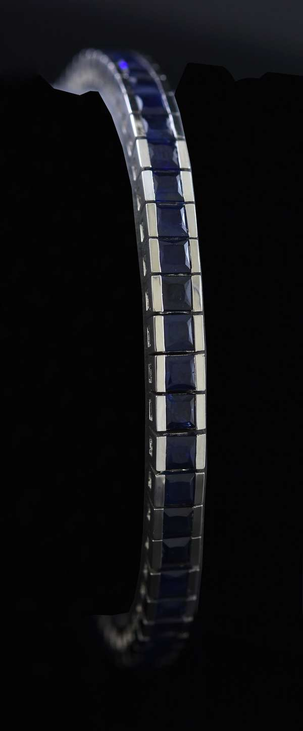 "18k white gold line bracelet set with approx. 10 ctw square blue sapphires, 7""L., 22.4 grams"