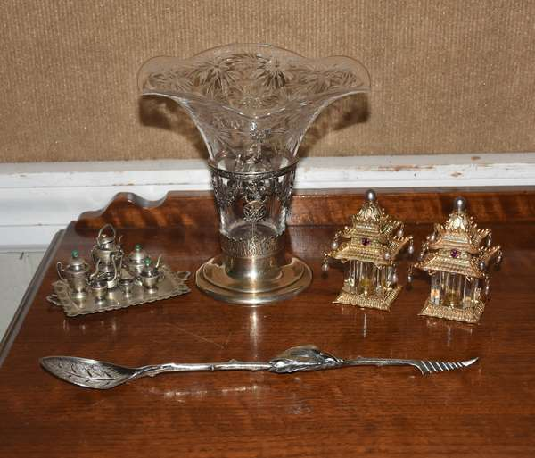 """Lot including sterling and glass vase, Black Starr & Frost, 7""""H.; marked sterling spoon with fruit decoration, 11""""L.; a miniature Mexican sterling tea set, 7 pieces, tray 4.75"""" - 2.5""""; and a pair of L'Objet salt and pepper shakers, with pearls and crystals"""