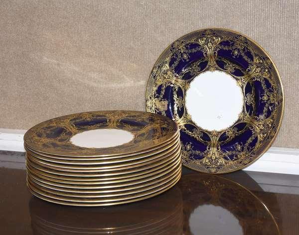 "Set of 14 Royal Worcester cobalt and gold bone china dinner plates, 10.5"" dia."