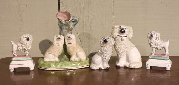 """Group of five small Staffordshire dogs, including spill vase, 6""""H, and two on stands, 3.5"""" - 4.5""""H"""