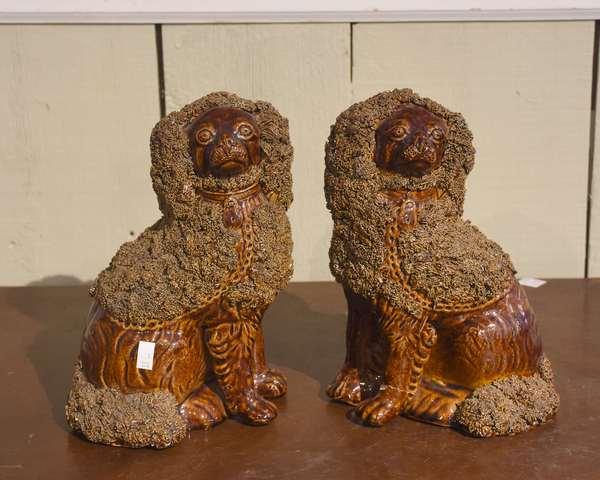 "Pair of 19th C. Bennington-type brown glazed spaniels 9.5""H."