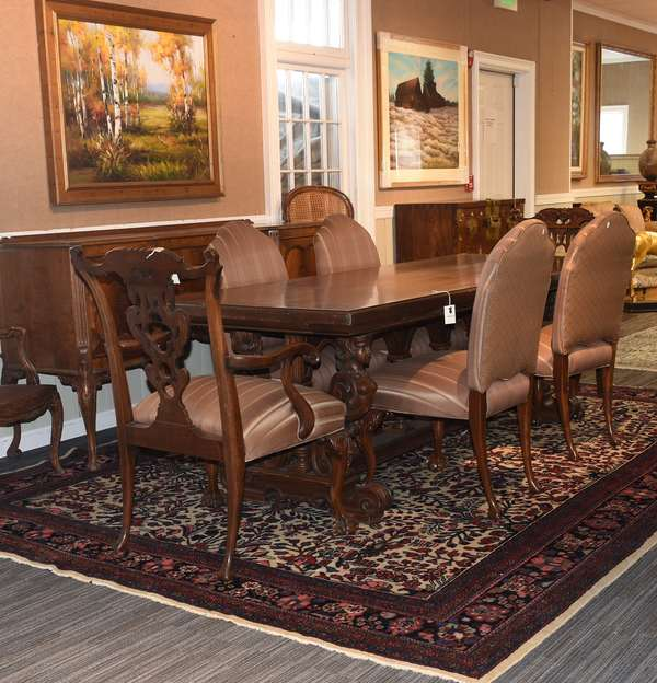 Set of 6 Chippendale style dining chairs with claw and ball feet, two arms and four sides, in brown striped upholstery