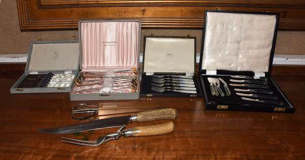 Four boxed sets of flatware with glass and mother-of-pearl handles, including 12 sterling cocktail spoons/straws, approx. 5.5 toz, with bone handled carving set, and shears, 38 pieces (37,38,35)