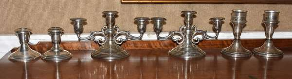 """Three pairs of weighted sterling silver candle holders, one three-branch, 3.5"""" - 4.5""""H."""