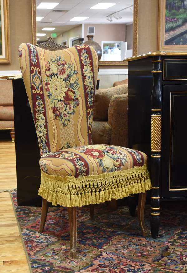 Set of ten French style upholstered dining chairs with fringe seats and carved top crest