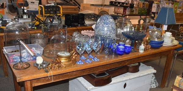 Many table lots of miscellaneous including porcelains, stemware, table lamps, clocks, etc.