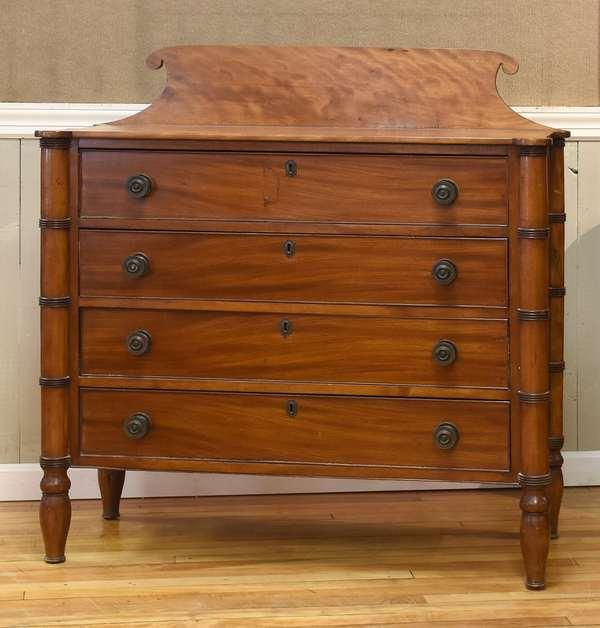 "Sheraton cookie corner four drawer chest, in figured birch, 43""L. x 18""D. x 45""H."