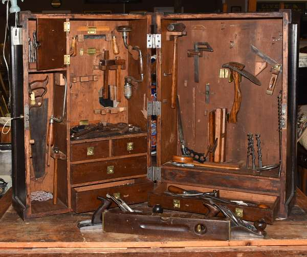 """Old wooden tool chest, paint decorated with """"E.E. Shannon"""", fitted interior including old tools, planes, saws, mallets, etc."""