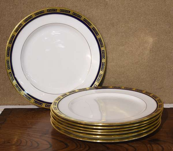 """Set of Royal Doulton dinner plates, blue and gold border, 7 pieces, 10.5"""" Dia."""