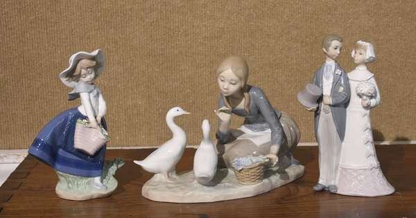 """Three Lladro figurines, girl with ducks, 9""""W. x 7""""H., bride and groom, 7.5""""H. and girl with flower basket, 7""""H."""