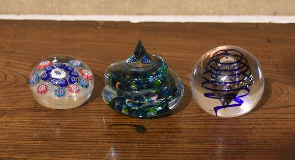 """Three glass paperweights, flower and spiral design, 2.5"""" - 3.5""""Dia."""