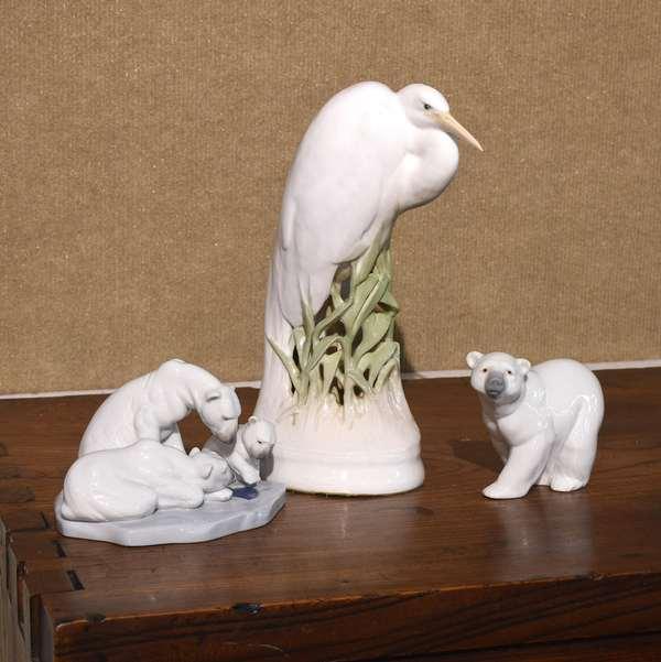 "Large Royal Copenhagen heron figurine, 10.5""H, with two Lladro polar bear figurines, 4""H."