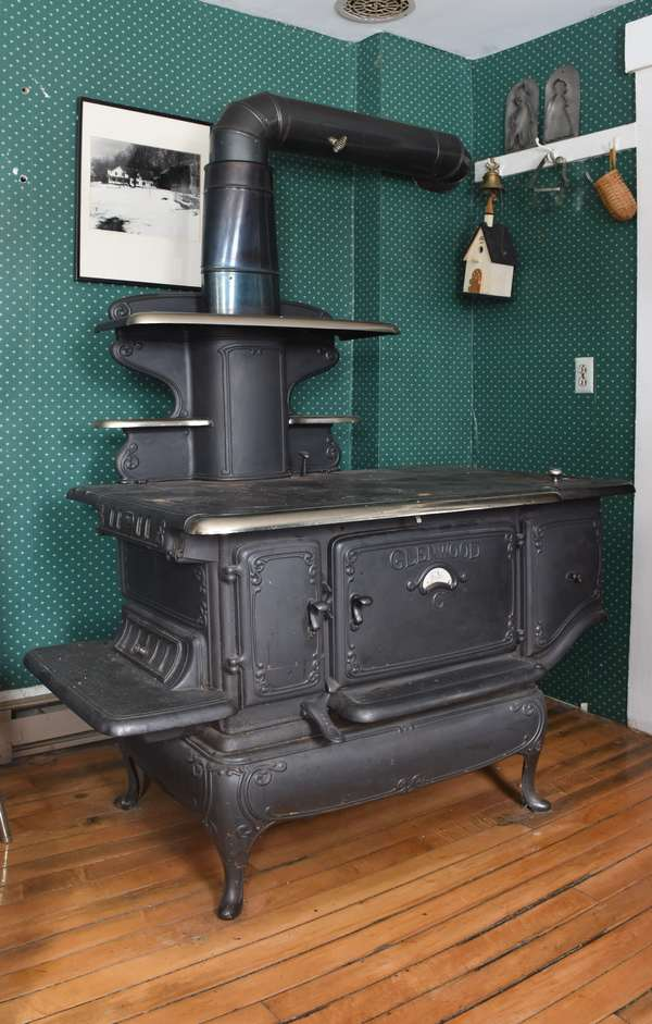 """Glenwood kitchen range stove with book by Donald Hall """"Lucy's Christmas"""" which pertains to the stove, 56""""L. x 51""""H. x 33 """"D. (897-1)"""