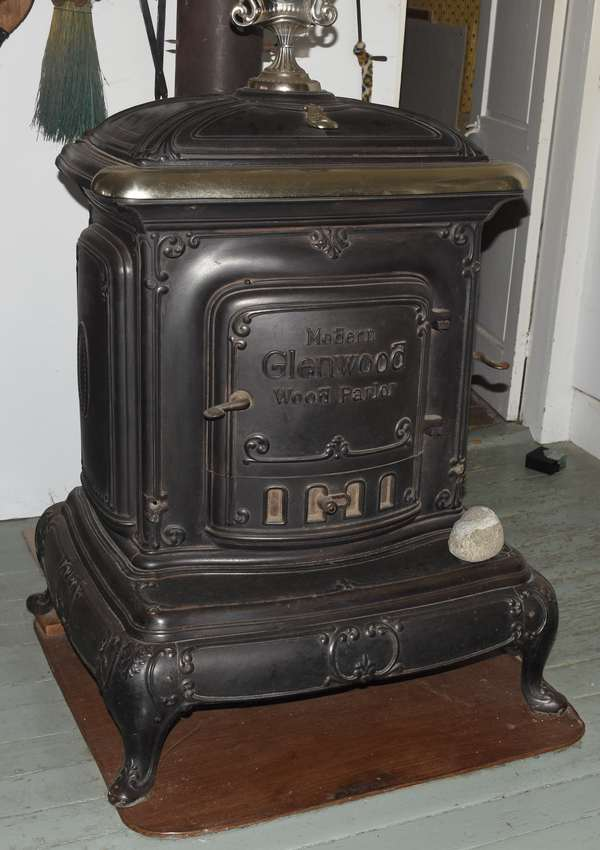 """Glenwood parlor stove with book by Donald Hall mentioning the stove in book, 29.5"""" x 39""""H. x 25""""D. (897-29)"""